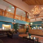 wood paneled front desk and lobby area of the Summit Inn